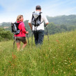 Back view of senior couple hiking in countryside — Stock Photo