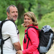 Portrait of smiling hikers in forest pathway — Stock Photo #13940404