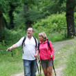Retired elderly hiking in forest pathway — Stock Photo