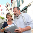 Royalty-Free Stock Photo: Mature couple in seaside resort looking at map