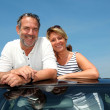 Senior couple in convertible car enjoying day trip — Stock Photo #13940572