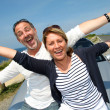 Senior couple in convertible car enjoying day trip — Stock Photo