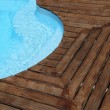Closeup of swimming pool with wooden floor around — Stock Photo #13940634
