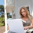 Womworking at home on laptop computer — Stock Photo #13940773