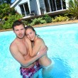 Young couple in private swimming pool — Stock Photo