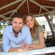 Smiling couple standing in private home gazebo — Stock Photo