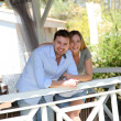 Smiling couple standing in private home gazebo - Stock Photo
