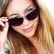 Portrait of blond woman with sunglasses on — Stock Photo