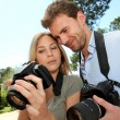 Couple looking at pictures through camera screen — Stock Photo