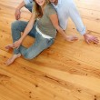 Couple at home relaxing on the floor — Stock Photo #13940954