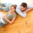 Couple at home relaxing on the floor — Stock Photo #13940957
