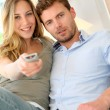 Couple in sofa watching tv — Stock Photo