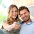 Couple in sofa watching tv — Stock Photo #13940961