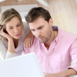 Couple at home using laptop computer — Stock Photo #13941463