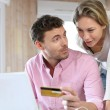 couple using credit card to shop online — Stock Photo #13941480