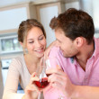 Happy couple cheering with glass of wine — Stock Photo