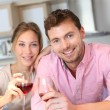 Happy couple cheering with glass of wine — Stock Photo #13941563
