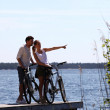 Couple standing on a bridge with bicycles — Stock Photo