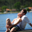 Couple relaxing on a lake bridge in summertime — Stock Photo #13941743