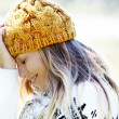 Portrait of blond woman in winter clothes and accessories — Stock Photo
