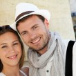 Portrait of smiling couple in town — Stock Photo