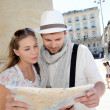 Couple holding a touristic map of Bordeaux — Stock Photo #13941860