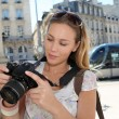 Portrait of young tourist looking at camerscreen — Stock Photo #13941876