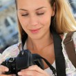 Portrait of young tourist looking at camera screen — Stock Photo