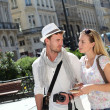 Young couple visiting city in summertime — Stock Photo