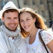 Smiling couple visiting French city in summertime — Stock Photo