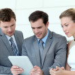 Stock Photo: Business team working with electronic tablet