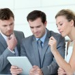 Business team working with electronic tablet — Stock Photo