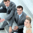Upper view of business team sitting in stairs - Stock Photo