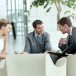 Business meeting in airport lounge — Stock Photo