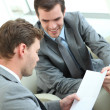 Businessmen discussing conditions of contract - Stock Photo