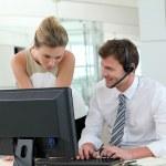 Business meeting in office in front of desktop — Stock Photo