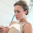 Active businesswoman in airport with smartphone — Stock Photo #13942441
