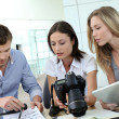 Team of photo reporters working in office - Stockfoto