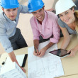 Upper view of team of architects working in office — Stock Photo #13942503