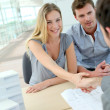 Couple shaking hand to real-estate agent in office — Stock Photo #13942536
