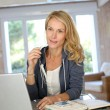 Stock Photo: Attractive middle-aged womworking at home