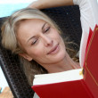 Portrait of woman reading book outside — Stock Photo