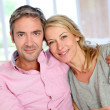 Middle aged couple relaxing in sofa at home — Stock Photo #13942949