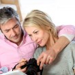 Royalty-Free Stock Photo: Couple at home looking at pictures on electronic tablet
