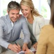 Couple meeting advisor at home — Stock Photo #13943182