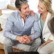 Couple meeting advisor at home — Foto Stock