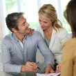 Couple meeting advisor at home — Stock Photo