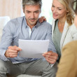 Couple meeting advisor at home — Stock Photo