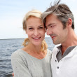 Couple embracing each other on a bridge by a lake — Stock Photo