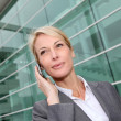 Close up of middle aged woman talking on cellphone - Stock Photo